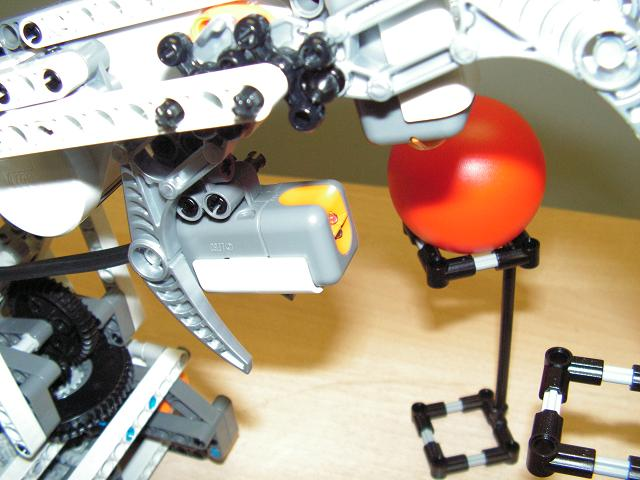 LEGO robot arm with light sensor shown.